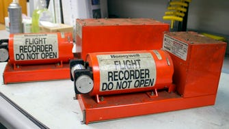 The flight data recorder, left, and the cockpit voice recorder from Asiana Airlines Flight 214 are shown at the NTSB's Washington headquarters.