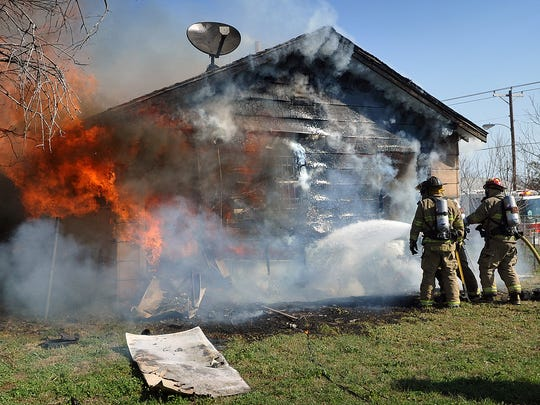 Wichita Falls firefighters battle a house fire Wednesday morning in the 600 block of Dallas Street. The home was a total loss.The lone occupant of the house was uninjured.  Investigators think it was caused by an electrical malfunction.