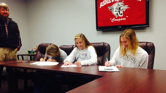 Asheville High seniors Ellie Stone, Hannah Sirkin and Kathryn Ahearne have signed to play college soccer.
