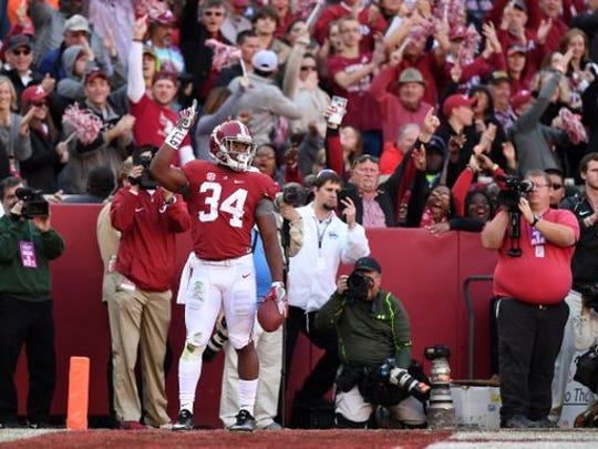 Alabama Crimson Tide running back Damien Harris (34) celebrates his touchdown against the Auburn Tigers during the first quarter at Bryant-Denny Stadium. Mandatory Credit: John David Mercer-USA TODAY Sports