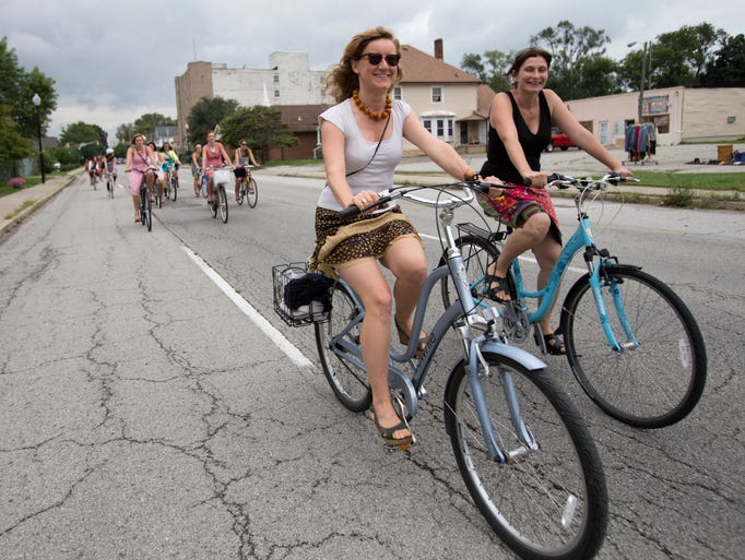 """A few of the 60 participants in the inaugural Skirt Ride, geared for women who want to get out and enjoy Indianapolis by bicycle in a leisurely fashion, Saturday, September 6, 2014. The ride started with a mimosa and baked goods party and spent three hours visiting several neighborhoods in the central part of the city, and was open for men as well.  """"This is different than the spandex crowd,"""" Frey said, """"I was always intimidated on group rides. Skirts show casualness."""" For more information about future events, after Monday, September 8th, look on Facebook for Indy Skirt Ride."""