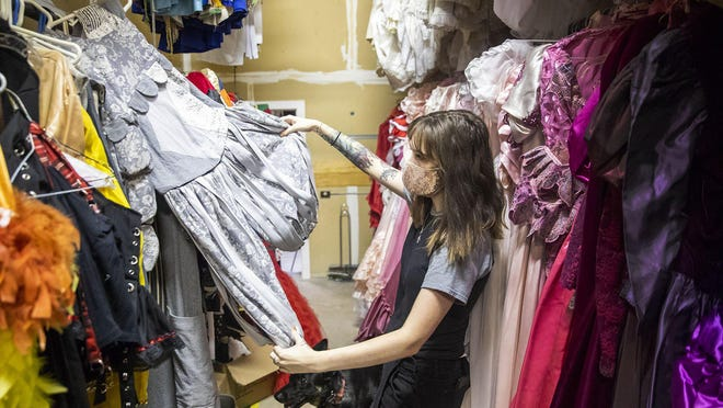 Jennifer Butler, co-owner of A Cut Above Costumes in Round Rock, looks through costumes in one of the company's warehouses. With the coronavirus pandemic taking a bite out of the businesses, A Cut Above is looking for additional revenue streams, Butler said.