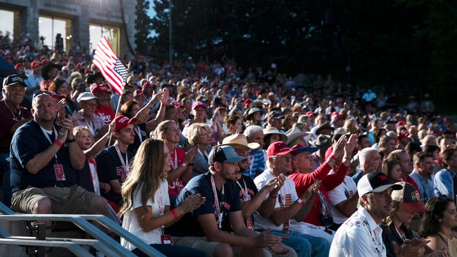 Supporters cheer as President Donald Trump speaks at Mount Rushmore National Memorial, Friday, July 3, 2020, near Keystone, S.D.