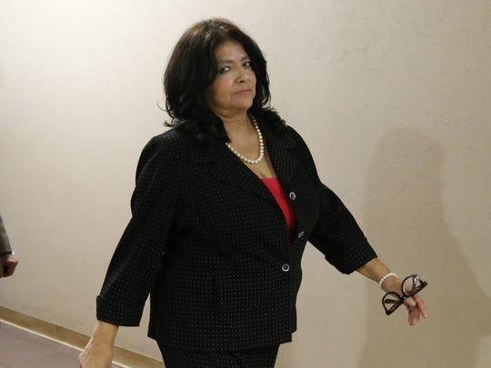 Former state Rep. Norma Chávez walks out of the 205th