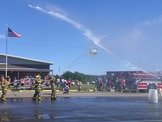Local firefighters take part in 'water wars' at a past