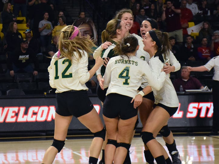 Members of Wilson Memorial's volleyball team embrace