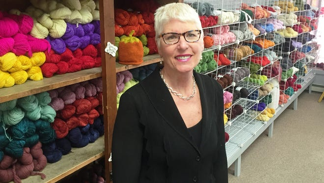 Sheri Louks, owner, stands inside The Knitting Room.