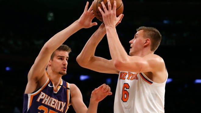 Nov 3, 2017: New York Knicks forward Kristaps Porzingis (6) shoots over Phoenix Suns forward Dragan Bender (35) during first half at Madison Square Garden.