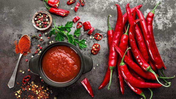 Eating extremely spicy foods may heat you up by stimulating the metabolism, and being too warm makes it hard to sleep.