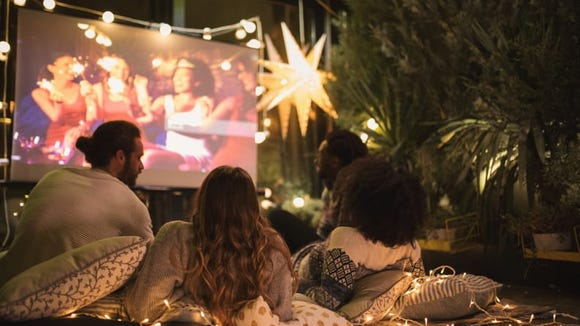 Bring the big screen to your backyard with a projector and show your favorite flicks. Grab a cheese board to feel sophisticated, or classic buttered popcorn for the full experience.