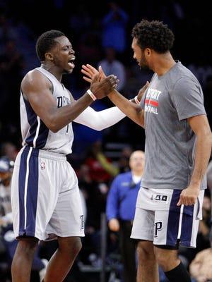Reggie Jackson, left, and Darrun Hilliard celebrate a big bucket in the Pistons' win.