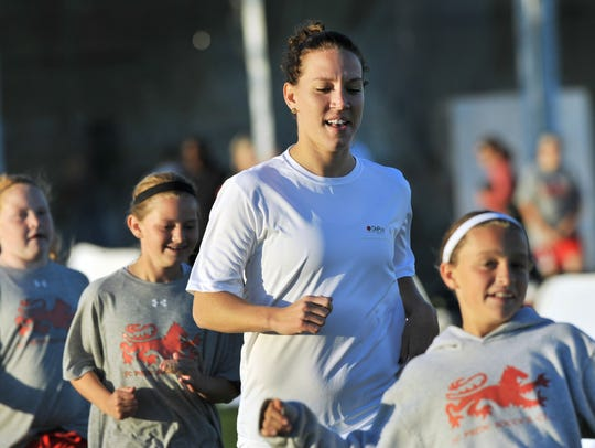 FILE – Lauren (Cheney) Holiday joins girls from the