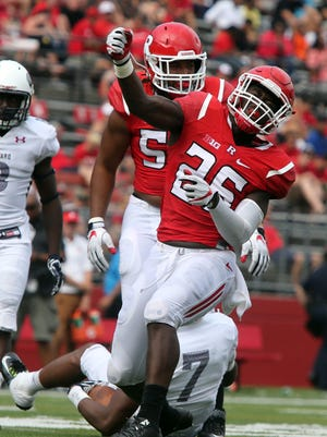 Rutgers Scarlet Knights new head football coach Chris Ash coaches his first home game at High Point Solutions Stadium in Piscataway against the Bisons of Howard University on Saturday September 10, 2016.Rutgers # 26 Deonte Roberts celebrates after taking down Howard's # 7 Anthony Philyaw for a loss of yardage.