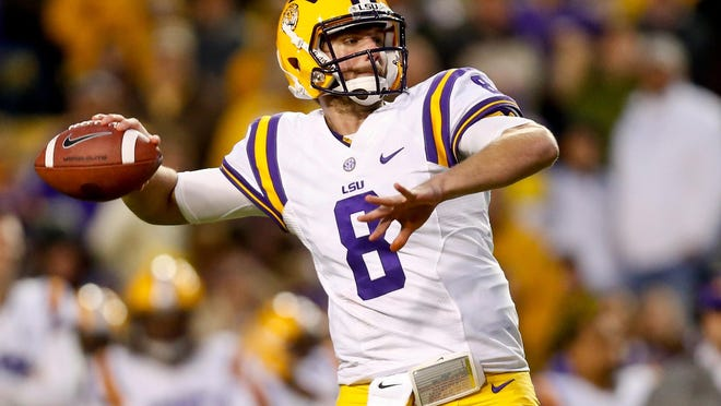 LSU Tigers quarterback Zach Mettenberger was chosen in the sixth round by the Tennessee Titans. USA TODAY Sports Nov 23, 2013; Baton Rouge, LA, USA; LSU Tigers quarterback Zach Mettenberger (8) against the Texas A&M Aggies during the second half of a game at Tiger Stadium. LSU defeated Texas A&M 34-10. Mandatory Credit: Derick E. Hingle-USA TODAY Sports