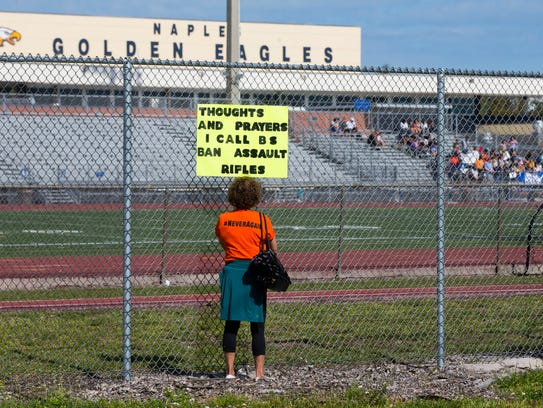 Cindy Nayer stands outside the Naples High School property