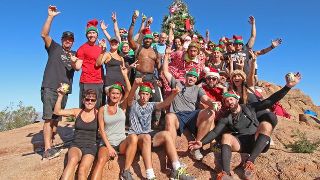 A group of about 50 hikers carry a 15-foot Christmas tree to the summit of Camelback Mountain the day after Thanksgiving, for the fourth year in a row. The tree was later removed by park rangers.