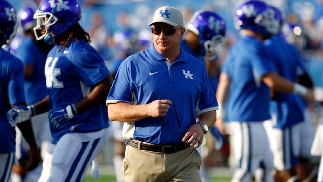 Kentucky Wildcats head coach Mark Stoops before the game against the Louisiana Lafayette Ragin Cajuns at Commonwealth Stadium. Kentucky defeated Louisiana Lafayette 40-33.