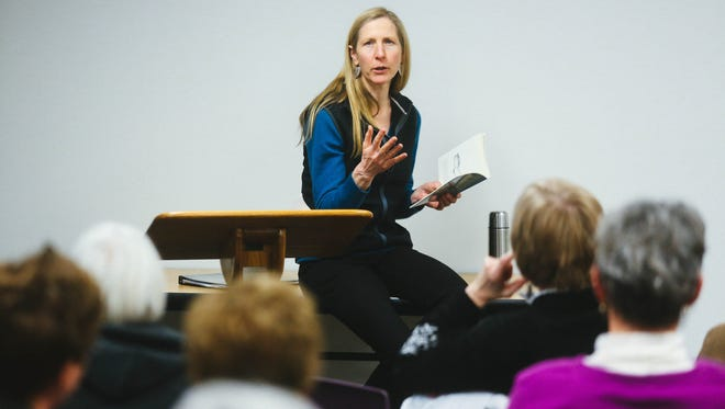 Kalamazoo author Bonnie Campbell shares stories about learning to make fudge during a reading at the People's Church in Kalamazoo on Wednesday, March 19, 2014.