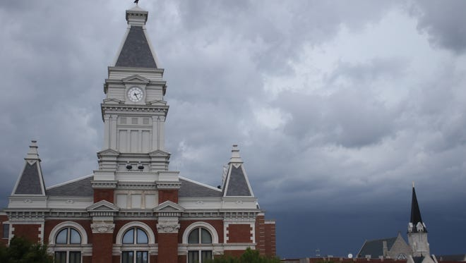 Storm clouds roll in over downtown Clarksville on Thursday, July 7, 2016.