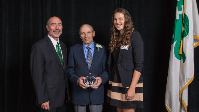 Jerry Micke, center, and his late wife, Jan, were inducted into the Wisconsin 4-H Hall of Fame on Nov. 5 at Green Lake Conference Center. He is pictured with Wisconsin 4-H Youth Development Program Director Dale Leidheiser, left, and Wisconsin Leadership Council Youth President Sarah Schuster, right.