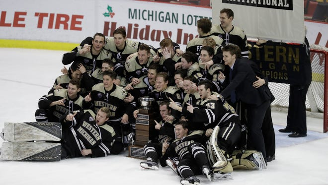 Western Michigan poses after WMU's 1-0 overtime win over Michigan Tech in the Great Lakes Invitational final Friday at Joe Louis Arena.