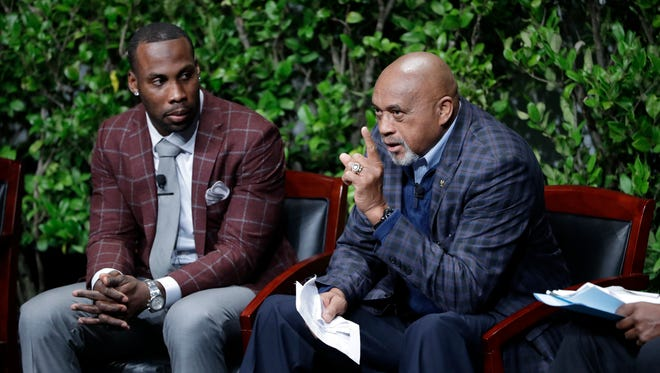 "Former U.S. Olympian Tommie Smith, right, speaks as NFL wide receiver Anquan Boldin listens during a sports and activism panel entitled ""From Protest to Progress: Next Steps"" Tuesday, Jan. 24, 2017 in San Jose, Calif."