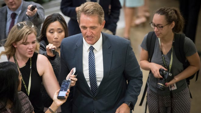 Sen. Jeff Flake, R-Ariz., arrives for weekly policy meetings on Capitol Hill in Washington, on July 11, 2017.