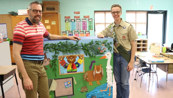 Trent Ducett, a teacher at Rockvale Elementary, stands with Eagle Scout hopeful Ryan Heath. A senior at Blackman, Heath created a sensory cart for special education students at Rockvale, where he was first introduced to scouting.