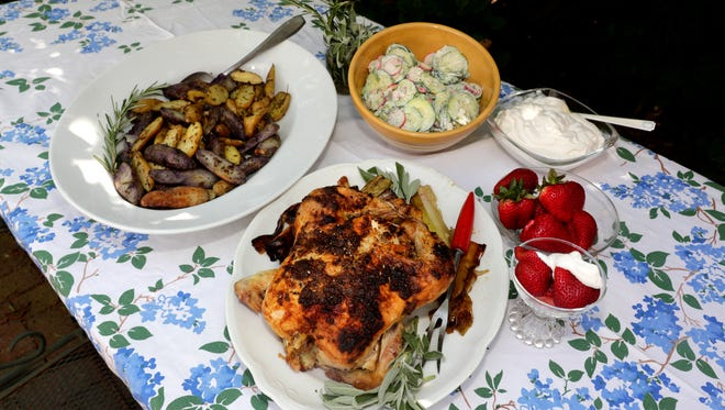 A summer farm-to-table menu includes roast chicken with herbs, fingerling potatoes with herbs, cucumber salad and, for dessert, fresh strawberries and Swedish whipped cream.