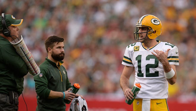 Green Bay Packers quarterback Aaron Rodgers talks to coach Mike McCarthy during a timeout against the Tampa Bay Buccaneers during the fourth quarter of Sunday's game at Raymond James Stadium in Tampa, Fla.