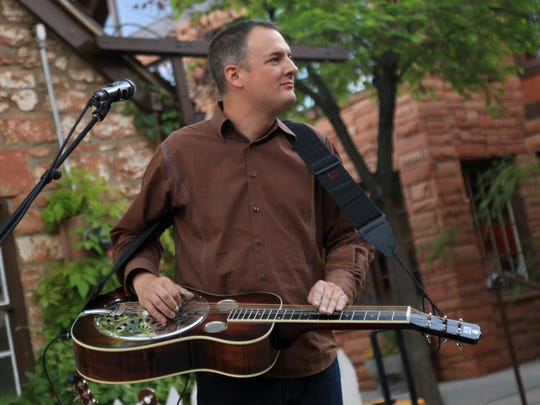 Ryan Tilby performs with Nic Chamberlain at Ancestor Square in St. George.