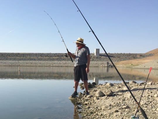 Ruben Ibarra fishes at Lake Success Tuesday. He said