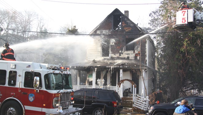Yonkers firefighters put down a fire at 7 Rider Ave. early Thursday, April 16, 2015.