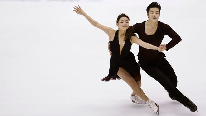 Maia Shibutani and Alex Shibutani, who train at The Arctic Pond in Canton, perform during the Ice Dance Free Dance program Friday at the Taiwan ISU Four Continents Figure Skating Championships in Taipei, Taiwan. The siblings won the ice dance championship.