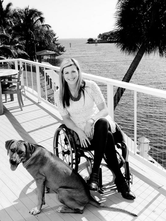 Jessica Andre, 27, at home in Melbourne. She was injured in a fall at the Daytona Speedway,and is now in