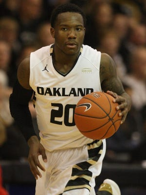 The Oakland Golden Grizzlies' Kahlil Felder brings the ball up court against the Detroit Titans on February 15, 2015. Oakland will be either the No. 2 or No. 3 seed in the Horizon League Tournament.