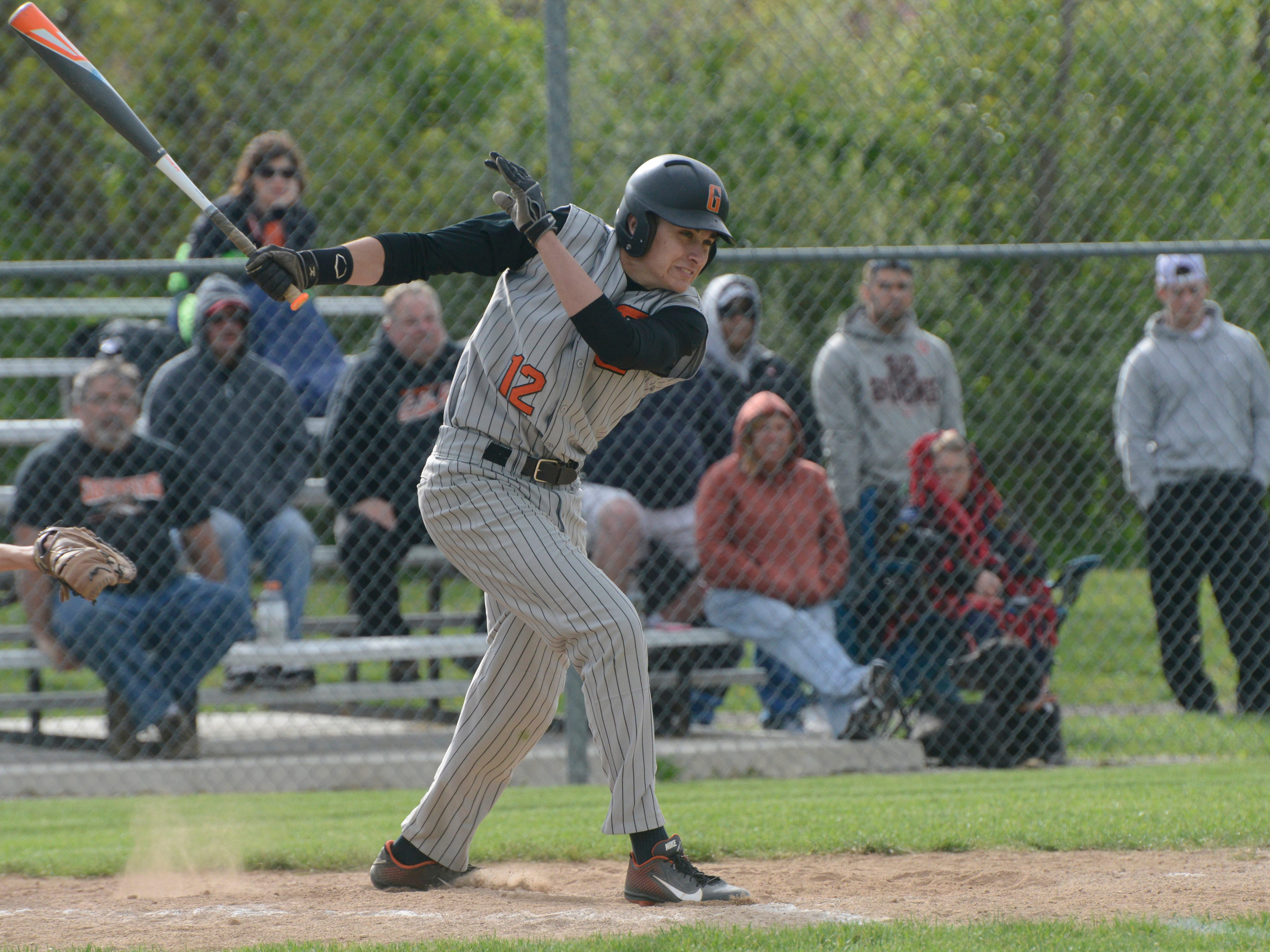 Gibsonburg's Andrew Dellinger swings in an at-bat against Old Fort on Wednesday afternoon.