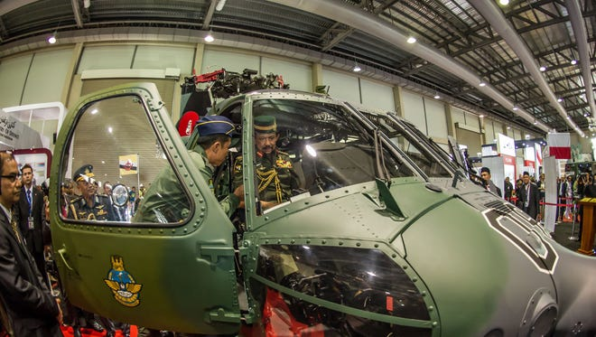 The Sultan of Brunei inspects a Sikorsky S-70i(TM) BLACK HAWK helicopter during the Brunei International Defence Exhibition.