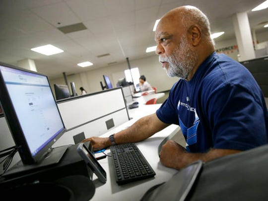 Air Force veteran Thom Brownell uses a computer to search for a job at the Texas Workforce Solutions office in Dallas, Friday, March 10, 2017. U.S. employers added a robust 235,000 jobs in February and raised pay at a healthy pace, making it all but certain that the Federal Reserve will raise short-term interest rates next week. Friday's jobs report from the government made clear that the economy remains on solid footing nearly eight years after the Great Recession ended.