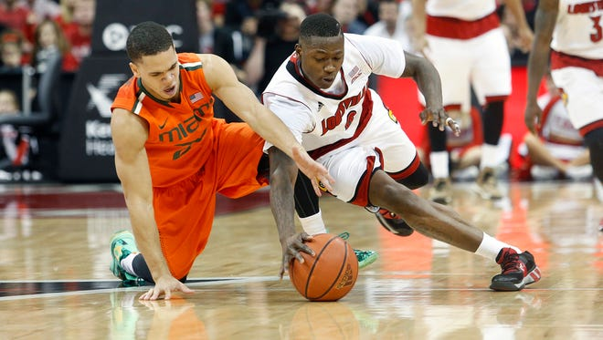 Louisville's Terry Rozier steals the ball from Miami's Omar Sherman.  Feb. 21, 2015