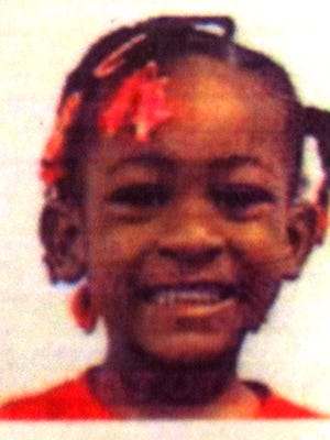 The photo from an identification card of Marie S. Pierre, 5, who was found dead at her Muncie home June 22, 2013.
