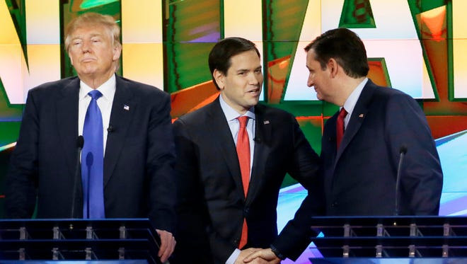 Republican presidential candidate Donald Trump (left) waits Feb. 25, 2016, as fellow GOP presidential candidates Sen. Marco Rubio, R-Fla., (center) and Sen. Ted Cruz, R-Texas, talk during a break in a primary debate at the University of Houston in Houston.