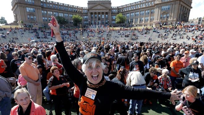 El Paso High School alumna Cynthia Skevington Bumb shows her excitement as the school attempts to break a world record for the largest high school reunion. The Tigers came up about 700 short.