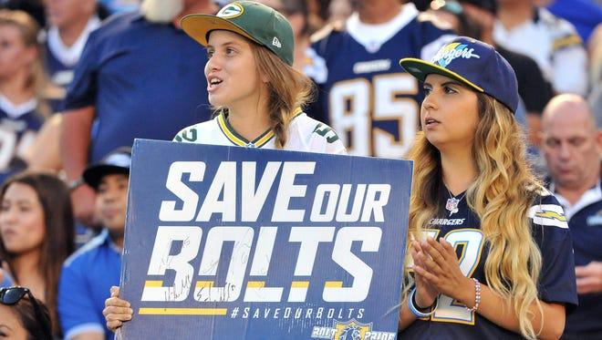 Fans hold up a sign in reference to the Save Our Bolts initiative during a recent Chargers game at Qualcomm Stadium.
