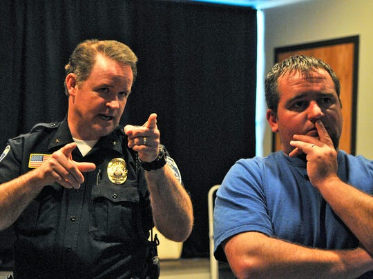 Becker Police Chief Brent Baloun coaches City Council member Adam Oliver during firearm simulation training Thursday.