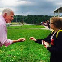 Retiring White House Middle School Principal Jerry Apple fist bumps Taelor Watson, 10, on Thursday, May 26, 2016, the last day of school.