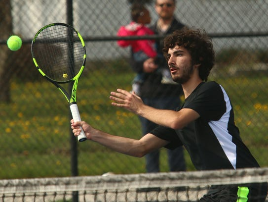 Lexington's Christian Zupan hits a forehand volley