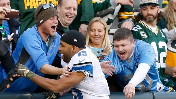 Detroit Lions wide receiver Golden Tate celebrates