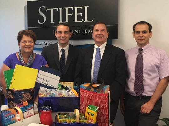 STOCKWELL STARS - The Stifel Ruder Investment Group office adopted  the Stockwell Stars and sponsored a school supply drive. A graduate of Stockwell Elementary School, Bryan Ruder delivered the supplies personally.  Pictured from left  are Sharon Ruder,  Bryan Ruder, Thomas Ruder  and Robert Kozsan.