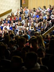 Students at Cedar Crest Middle School listen on May 4, 2016, to Jerry Mitchell, of the Pennsylvania Office of Attorney General, as he speaks about the repercussions of bullying behavior.